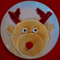 ⊰✲⊱ Reindeer Pancakes ⊰✲⊱  One large Pancake for Head ( and two bits for ears )  One small Pancake for Mouth  One strawberry ( or fruit of choice ), for the Nose Two raisins, chocolate chips etc.. for Eyes - use a dab of Cool Whip for the whites of the eyes. and ... Bacon for the Antlers !