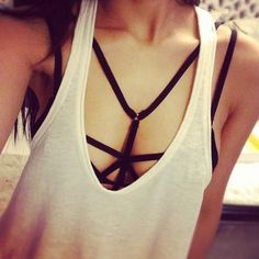 strappy bralette under shirt. this was the thing from constantine... found it…
