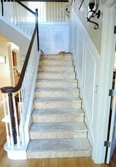 Turn oak to dark brown railing. Love it  but would still carpet stairs in dark decorative carpet.