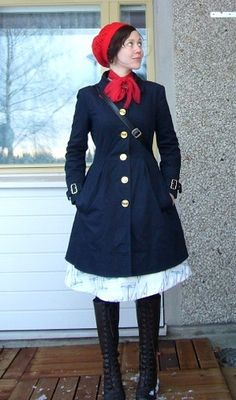 navy coat + red scarf + lace-up knee-high boots