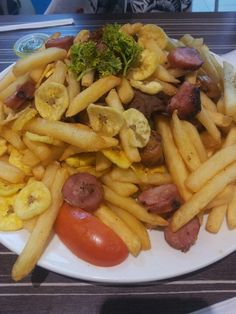 Food at La Estancia - located in Panama city. Panama it plantains, french fries, sausage, chicken and pork!!! omg it was so cool... i have to share cuz i was eating in the first 2minutes and i didnt see the end.... lol!!! 2or3 person that plate .