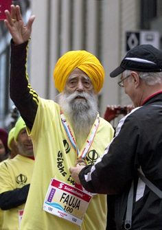 Fauja Singh, 100, receives a finishing medal after crossing the line in the Toronto Waterfront Marathon in Toronto on Sunday, Oct. 16, 2011.  Guinness Book of World Records has acknowledged the feat, but are awaiting awarding a world record for oldest marathon finisher until documentation supporting Singh's age claims are received.  Pretty amazing for a centenarian.