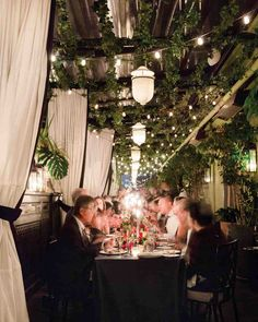 A Bold, Autumnal Wedding in NYC | Martha Stewart Weddings - Guests dined on fusion cuisine under hanging greenery and twinkling cafe lights.