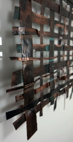 A unique medium size Copper Weave metal wall art panel offset mounted on a white acrylic base. This copper weave panel is made from up-cycled copper pipe of ...