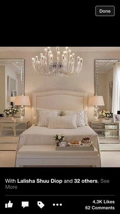 Pretty White Bedroom, With The Large Glass Mirrors, Chandelier, Lamps And  Seating, At The End Of Bed .
