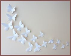 White 3D wall Butterflies (on a turquoise wall - idea for bedroom). I wonder if they'll work with birds. I love birds.