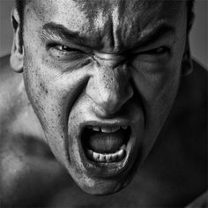 Anger, angry face, wild, intense, powerful expression, emotional, eyes, portrait, photo b/w.