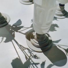 Beautiful shadows on vase handmade from bottles of soda brand mogumogu.