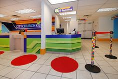 The vibrant colors and shapes makes this children's ministry check in so inviting!