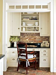 Cute desk area off side of kitchen for scheduling. love brick back splash- room for this for me, by kids homework station?