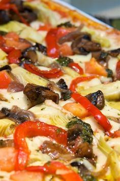 #italianfood #pizza #vegetablepizza Doesn't this pizza make your mouth water? Look at those fresh ingredients piled on, all hot and toasted from the oven. All of the flavors ha...