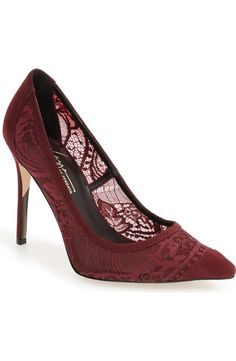 This romantic pointy-toe pump in dainty lace and suede adds an alluring touch when paired with a sleek black dress.