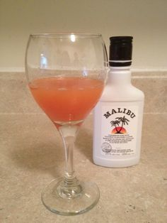 This cocktail is made with equal parts rhubarb juice and orange juice with a splash of Malibu coconut rum. It is a refreshingly sweet and sour drink with a hint of coconut. The rum is optional.