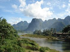Laos - lush scenery, friendly people, and drinking your way down the river while floating on an inner tube!