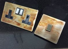 Pushing the boundaries of shabby chic aged vintage with these rusty electrical socket and switch faceplates