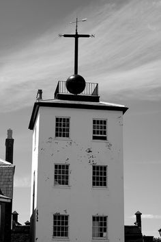 Deal Timeball Tower.    Deal Timeball is a Victorian maritime Greenwich Mean Time signal located on the roof of a waterfront four-storey tower in the coastal town of Deal, in Kent, England. It was established in 1855 by the Astronomer Royal George Bidd