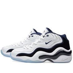 """Forever a part of Penny Hardaway's footwear history, Nike's Air Zoom Flight 96 was originally worn by the legend in the summer of '96s global battle. Back for a re-release, the Zoom Air-equipped model that kept him at his best returns with a luxurious, gold accented design that's fit for battle. Finished with Penny's stamp of approval in his jersey number 6 stitched on the heel.  Leather Uppers Synthetic Overlays Olympic Themed Colourway Embroidered """"6"""" to Heel Ice Blue Rubber Outsole Sty..."""