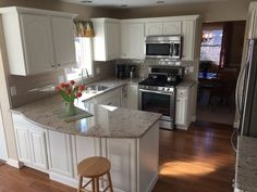 Our kitchen remodel: Oak cabinets painted white. We used Sherwin Williams Dover White ProClassic Acrylic Interior Enamel in semigloss. Countertops are Cambria Windermere