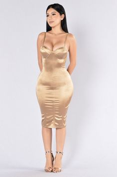 - Available in Burgundy and Gold - Satin Fitted Dress - Adjustable Spaghetti Straps - Padded Cups - Midi Length - 94% Polyester 6% Spandex
