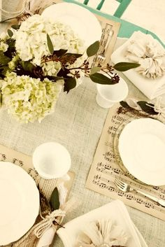 Vintage table-scape with sheet music. Could use book pages instead for the placemats.