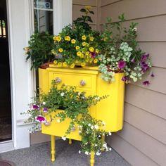 Sunshine Yellow antique dresser turned potting stand!