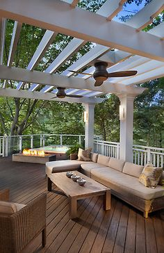 Lovely pergola with fans. Not the fans I'd pick. But this is what I'm thinking for our deck!!