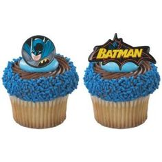Batman Cupcakes for Parker school.  Batman cupcake holders, yellow icing, bright blue sprinkles around outside and if can find some sort of cute topper in middle!