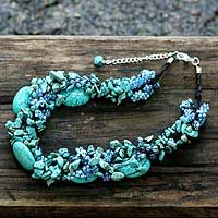 Gushing sky blue elegance, this necklace by Nareerat is designed to accessorize with trendy style