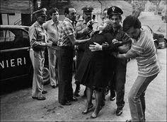 8 August, 1980, Capaci. Three killers have murdered the owner of Hotel Costa Smeralda. The woman, not knowing who has been killed , thinks the murdered man is her son. Photograph: Letizia Battaglia