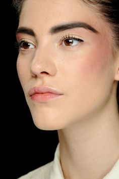 Bold brows, nude lips runway makeup, Chanel, Couture Fall 2013. Photo: Luca Cannonieri / InDigital | GoRunway