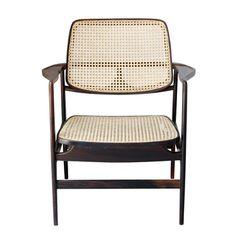 Sergio Rodrigues  Poltrona Oscar, estrutura em jacarandá maciço, assento e encosto em palhinha natural - década de 1960  Dimensão  68cm L x 65cm P x 80cm H