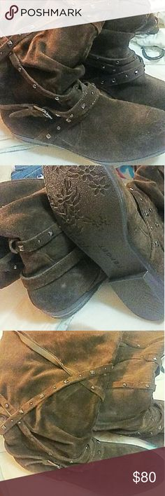 Ladies chocolate brown suede boots. Size 8 Very cute chocolate brown suede boots. Size 8 perfect for this cold weather and winter style. Shoes Combat & Moto Boots