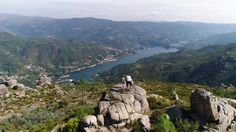Flight Father and Sons Admiring the Beautiful Nature and River Landscape by DREAM_LANDSCAPE Aerial View made by professional drone of family (father and two childreens) enjoying wonderful nature landscape view from top of Great Mountain Summer day with blue sky and puffy clouds in the background Portugal