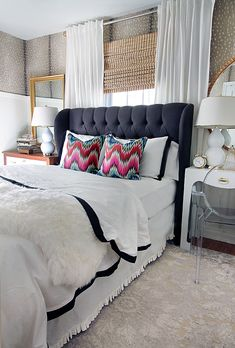 tufted headboard / black bordered bedding / Jonathan Adler pillows