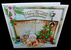 """A lovely festive scene of a vintage book and toys under a Christmas tree in the snow, with decorations & stockings, making this a very festive card that everyone in the family will love. This stunning mini kit makes an 8 inch square card & includes 3 sheets, the card front & 4 matching greeting tags, easy to cut out decoupage and a matching insert to make a very special card. The wooden sign style greeting tags are """"Merry Christmas"""" """"December"""" """"Christmas T..."""