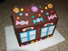 DIY Felt Gingerboard House kids can decorate over and over again- LOVE it!
