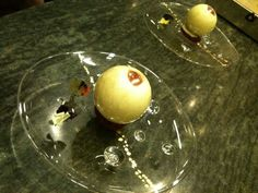 Perfection! Sugar sphere filled w/ passionfruit mousse, choc. Sorbet & fresh raspberries from Chef Salvatore Martone, executive pastry chef at L'Atelier de Joël Robuchon at the Four Seasons Hotel in NYC.