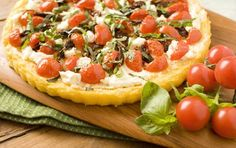 Many thanks to one of our readers for sharing this polenta crust recipe, a great gluten-free option that everyone will enjoy. It can be used as a base for any toppings you fancy. Here a thin layer of goat cheese, sweet cherry tomatoes and sun dried tomatoes makes a great combo.