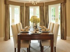 Dining Room Formal Decorating Ideas With Beautiful Flower Arrangement And Brown Drapes. dining room chairs