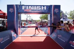 Top Finish Line Images: Ben Kanute proved he was the strongest collegiate triathlete in 2013 by winning the draft-legal and non-draft races and posting the fastest split in the Mixed Team Relax at the USA Triathlon Collegiate National Championships. Photo by Jason Wise.