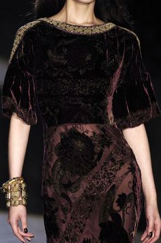 I love the deep purple velvet fabric with the hints of golden accents on the roman style neckline