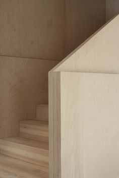 Minimalist stair guardrail detail | Wooden guardrail design | Living space Herning by Claus Pryds