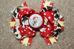 Jessie the cow girl from Disney Toy Story Custom Boutique Bottle Cap Hair Bow Clip - red, yellow, blue, cow print. $7.00, via Etsy.
