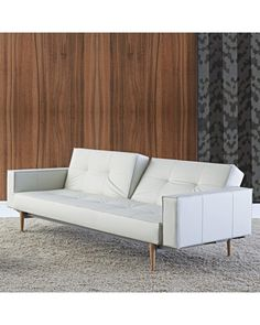 Dimensions: 82W x 45D in.; Seat: 15H in.. Multi-position conversion to twin-sized bed. Rigid metal frame with metal mesh support. Polyester fabric upholstery in color options. Foam casing and fiberfill over 7-in. pocket spring. Tufted back and seat. Wide, squared arms. Tapered wood legs in dark finish. Wipe clean with damp cloth, do not dry clean. Some assembly required. Designed to match your lifestyle, the Innovation Living Split Back Faux Leather Convertible Sofa with Dark Wood Legs goes…