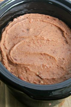 This Slow Cooker Refried Beans recipe is so easy to make! It's the perfect addition to - or side dish for - all of your Mexican dishes. Slow Cooker Refried Beans --- PIN THIS RECIPE --- Refried Beans Slow Cooker, Refried Beans Recipe Easy, Mexican Beans Recipe, Homemade Refried Beans, Beans In Crockpot, Mexican Food Recipes, Slow Cooker Recipes, Crockpot Recipes, Cooking Recipes