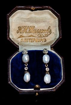 A Pair of Art Nouveau Baroque Pearl Drop Earrings, Russian, circa 1910 ~ The earrings are handcrafted in silver topped gold and set with old mine diamonds and four baroque pearls. They come in a brown leather case of Sholokhov jewelry shop in St. Petersburg. Both earrings are stamped with later Soviet control marks.