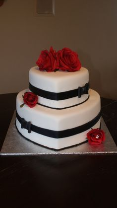 """Steph, Put a small box shaped """"gluten free"""" cake on the top of the heart, then top with your flower choice."""