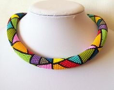 Bead crochet rope necklace is crocheted on 100% cotton thread with thousand of small Czech seed beads with geometric pattern .  Very flexible and
