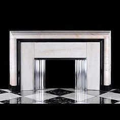 Large White and Black Marble Art Deco Fireplace - The lightly veined and figured ivory white surround bordered on the inside with Belgian black marble with stainless steel opening bordering and fireside fender, English, ca. 1930