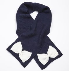 A-Dee navy scarf (matching hat available) with cream bow detail.